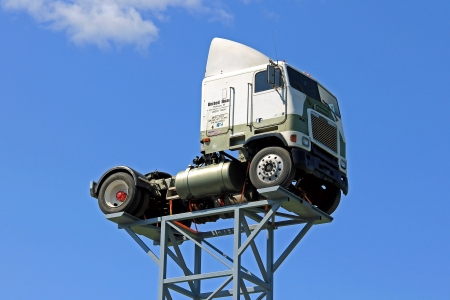 freightliner: KOSKI, FINLAND - JULY 7  Vintage Freightliner truck lifted up against sky on July 7, 2013 in Koski, Finland  Freightliner Trucks is an American truck division of Daimler Trucks North America LLC