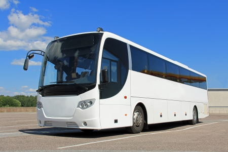 White coach bus in summer on a parking lot. Stock Photo