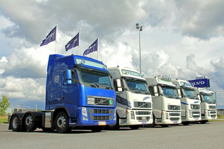 TURKU, FINLAND - AUGUST 31, 2013: Five Volvo FH trucks in a row. In November 2013, 9064 Volvo trucks were delivered within Europe, an increase of 22% compared to 112012.