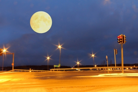 Full Moon over an empty crossing at night, filter applied. photo
