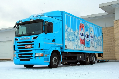 SALO, FINLAND - JANUARY 11, 2013: Scania R500 truck delivering beverages to a store. In Finland, a very common New Years resolution is not to drink any alcohol in January.