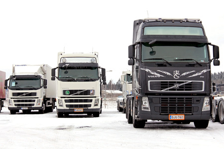 FORSSA, FINLAND - JANUARY 25, 2014  Group of Volvo trucks in winter conditions  Volvo Trucks has  developed a system known as Stretch Brake that significantly improves safety for slippery winter roads