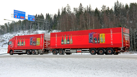 FORSSA, FINLAND - FEBRUARY 2, 2014  Moving Scania truck with wine trailers on the road  J P  J P  Chenet Reserve wines win Gold and Silver medals at Selection Mondiales des Vins Canada 2013