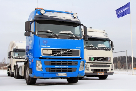 FORSSA, FINLAND – FEBRUARY 2, 2014  Used Volvo trucks on a yard  To improve road safety, Volvo Trucks have developed Driver Alert Support  DAS  which gives a signal when a driver is drifting off