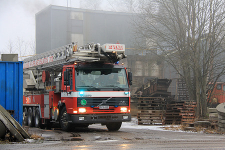 SALO, FINLAND - FEBRUARY 16, 2014  Volvo FL12 Fire truck arrives at Cement Plant fire scene in Salo  The fire at the plant breaks out twice on the same day