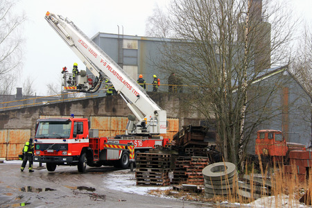 SALO, FINLAND - FEBRUARY 16, 2014  Firefightes extinguish the first Salo Cement Plant fire, but the second fire on the same day destroys the old factory