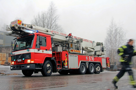 SALO, FINLAND - FEBRUARY 16, 2014  Fire Brigade arrives at the Cement Factory fire scene in Salo, Finland