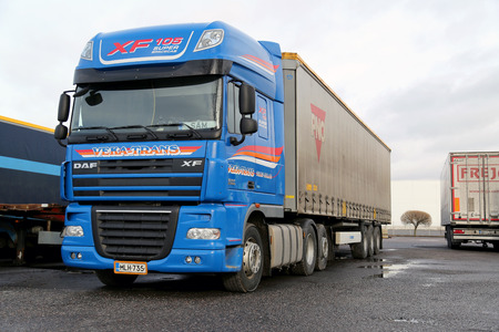tonnes: TURKU, FINLAND - FEBRUARY 23, 2014: Blue DAF XF 105.510 long haulage truck. DAF trucks achieves a market share of 16.2% in the heavy truck segment (16 tonnes+) in the European truck market in 2013, a record in the 85 year history of the company. Editorial