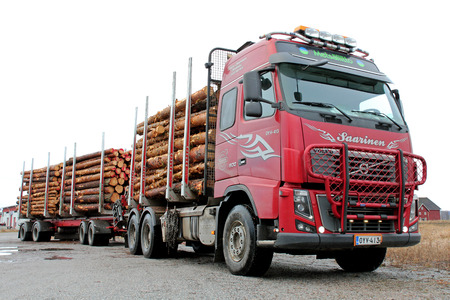 SALO, FINLAND - FEBRUARY 22, 2014: Volvo FH timber truck with a full load. Finnish Forest Industries Federation reports that in 2013 timber sales volumes were 18 per cent higher than in 2012.
