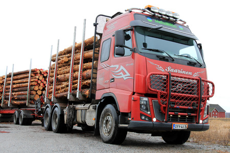 per cent: SALO, FINLAND - FEBRUARY 22, 2014: Volvo FH timber truck with a full load. Finnish Forest Industries Federation reports that in 2013 timber sales volumes were 18 per cent higher than in 2012. Editorial