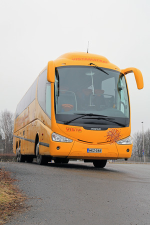 pb: SALO, FINLAND - MARCH 2, 2014  Scania Irizar PB Coach bus parked in Salo  Scania will launch an efficiency programme with the aim of ensuring profitability in its city bus operations