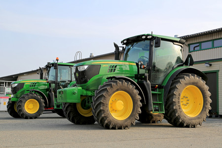 FORSSA, FINLAND - MARCH 1, 2014  John Deere 6150R and 6125M agricultural tractors on display Two John Deere innovations have won awards at the 2014 FIMA show held in Zaragoza, Spain in February