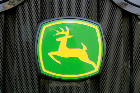 deere: FORSSA, FINLAND - MARCH 1, 2014   Sign John Deere on the front grille of an agricultural tractor  John Deere is awarded two silvers at Agritechnica 2013 in Hanover, Germany  Editorial