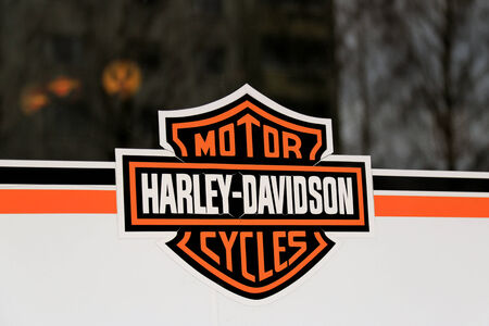continued: LOIMAA, FINLAND - MARCH 9, 2014  Weathered Sign Harley-Davidson Motorcycles on a store window  H-D delivers continued growth for fourth quarter and full year 2013