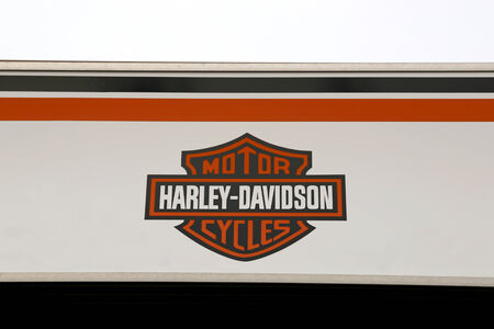 continued: LOIMAA, FINLAND - MARCH 9, 2014  Sign Harley-Davidson Motorcycles on a store wall with white sky  H-D delivers continued growth for fourth quarter and full year 2013