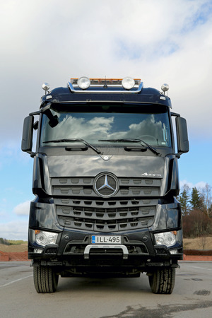 mpg: SALO, FINLAND - MARCH 22, 2014  Mercedes-Benz Arocs 3263 timber truck  The New Arocs has Euro VI engines that offer mpg savings of up to 5  Editorial