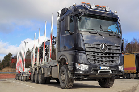 SALO, FINLAND - MARCH 22, 2014  Mercedes-Benz Arocs 3263 timber truck  The New Arocs has an Euro VI engine which can save fuel up to 5  mpg