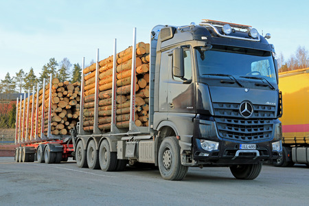 mpg: SALO, FINLAND - MARCH 22, 2014  Mercedes-Benz Arocs 3263 timber truck  The New Arocs has Euro VI engines that offer mpg savings of up to 5