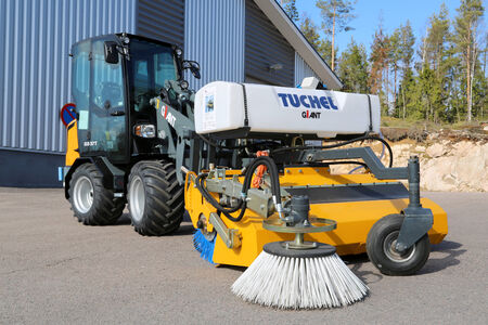 LIETO, FINLAND - MARCH 22, 2014  Giant D337T wheel loader with Tuchel Plus collecting sweeper on a yard  The benefits of collecting sweeper are easy sanitation in less time and no manual labor