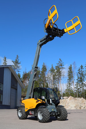 LIETO, FINLAND - MARCH 22, 2014  Giant 4548 Tendo telehandler with  clamps on display   The advantages of telehandlers compared to forklift and front loader are the versatility of scope and attachments