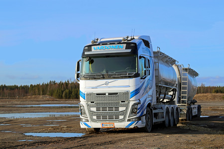 LIETO, FINLAND - MARCH 22, 2014  White Volvo FH tanker truck in dramatic landscape  The first Euro 6 versions of the Volvo FH16 will be delivered in early June