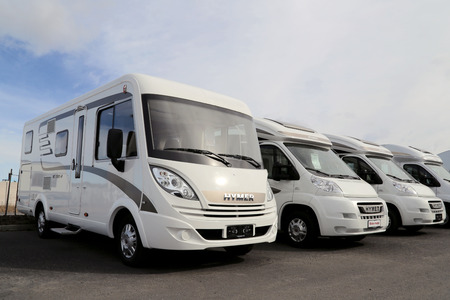 TURKU, FINLAND - MARCH 30, 2014  Hymer motorhomes parked in a row  Starting January 2014, Euro 5b  emission standards involve RVs and vans  Editorial