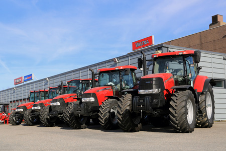 TURKU, FINLAND - APRIL 5, 2014: Five Case IH agricultural tractors displayed in a row. Case IH wins two gold medals at AGROTECH - the 20th International Fair of Agricultural Techniques 2014. Editorial