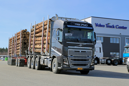 LIETO, FINLAND - APRIL 5, 2014  Volvo Trucks presents the new FH16 750hp timber hauler as part of their new truck range at Volvo Trucks and Renault Trucks roadshow