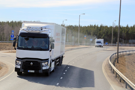LIETO, FINLAND - APRIL 5, 2014: New Renault Range T truck on a test drive. Renault Trucks presents their new range T for long haul at Volvo Trucks and Renault Trucks roadshow.