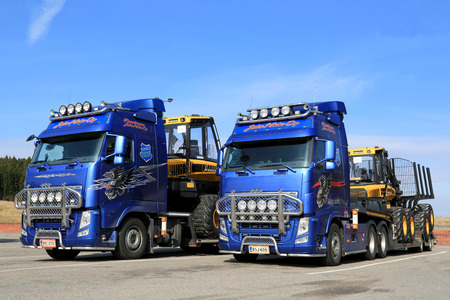 SALO, FINLAND - APRIL 18, 2014  Two Volvo FH13 Trucks hauling Ponsse forestry machinery  According to recent Interim report for Jan 1 to Mar 31, Ponsses order book grows by 112 per cent compared with the comparable period