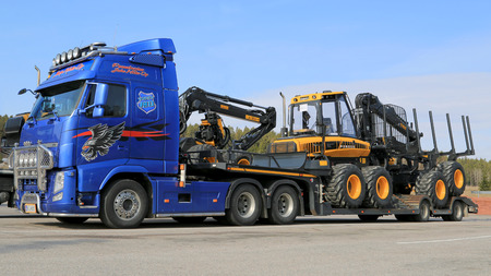 comparable: SALO, FINLAND - APRIL 18, 2014  Volvo FH13 Truck hauling Ponsse forestry machinery  According to recent Interim report for Jan 1 to Mar 31, Ponsses order book grows by 112 per cent compared with the comparable period