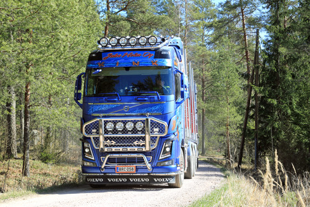 tl: KOSKI TL, FINLAND - APRIL 27, 2014  Customized Volvo FH16 750 timber truck on forest road  The first Euro 6 versions of the Volvo FH16 will be delivered in early June