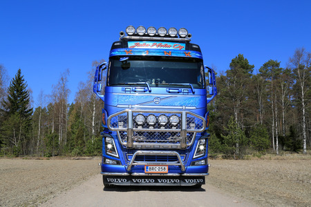 strongest: KOSKI TL, FINLAND - APRIL 27, 2014  Customized Volvo FH16 750 timber truck on rural road  With up to 750 hp and 3550 Nm of torque, the new Volvo FH16 retains its position as the strongest truck in the world