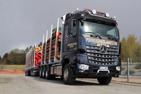 robustness: SALO, FINLAND - MAY 2, 2014  Mercedes-Benz Arocs 3263 LK 8x4 timber truck  In addition to being extremely environmental friendly, MB Arocs boasts three special attributes  power, efficiency, and robustness
