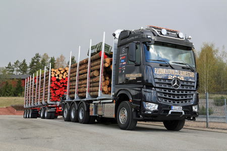mb: SALO, FINLAND - MAY 2, 2014  Mercedes-Benz Arocs 3263 LK 8x4 timber truck  In addition to being extremely environmental friendly, MB Arocs boasts three special attributes  power, efficiency, and robustness