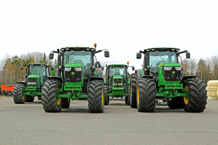 FORSSA, FINLAND - MAY 10, 2014  Four John Deere agricultural tractors,  two 6210R on the front row, 7530 and 6820 on the back  John Deeres Manure Sensing System is awarded in the technical innovation category at the FIMA 2014 show