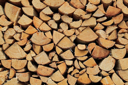 Background of chopped and stacked firewood for wood fuel. photo