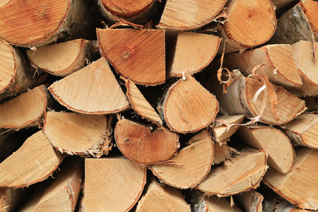 Background of chopped and stacked birch logs for firewood. photo