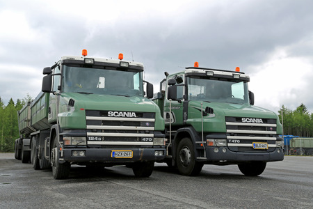 LIETO, FINLAND - MAY 30, 2014  Two older models of Scania 124G 470 gravel trucks with conventional cab  Long nose cabs may be the future, as the new proposed EU Weight and Dimensions Directive will allow for longer lorry cabins