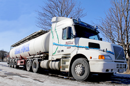 SALO, FINLAND - MARCH 31, 2013  Volvo NH12 420 tanker truck with conventional cab design  Long nose cabs may be the future, as the new proposed EU Weight and Dimensions Directive will allow for longer lorry cabins