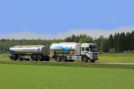 FORSSA, FINLAND - APRIL 19, 2014: Volvo FM tanker truck transporting Valio milk. The ca. 100 Finnish Valio milk trucks drive more than 24 million kilometers per year.