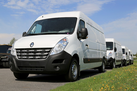 third wheel: FORSSA, FINLAND - MAY 25, 2014  Row of third generation Renault Master vans  Renault Trucks presents the new Renault Master at the CV show in Birmingham  Editorial