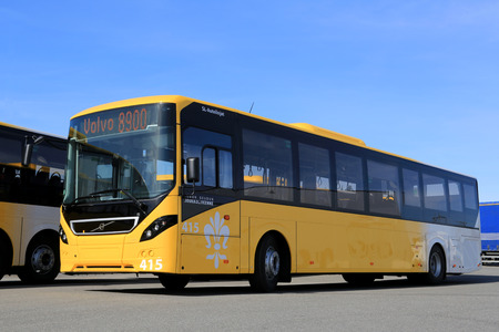 LIETO, FINLAND - APRIL 5, 2014  Yellow Volvo 8900 city bus parked on a yard  The 8900 has a Volvo D8K Euro 6 engine, which is one of the worlds most fuel-efficient bus diesel engines  Редакционное