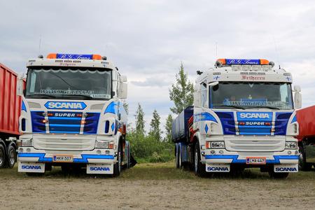 HATTULA, FINLAND - JULY 12, 2014: Two Scania tipper trucks on display at Tawastia Truck Weekend in Hattula, Finland.