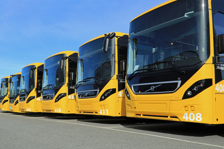 LIETO, FINLAND - APRIL 5, 2014  Row of Yellow Volvo 8900 intercity buses parked on a yard  The 8900 has a Volvo D8K Euro 6 engine, which is one of the worlds most fuel-efficient bus diesel engines