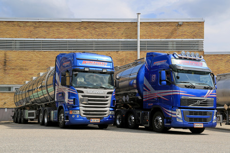 TURKU, FINLAND - JULY 13, 2014  Scania R440 and Volvo FH 460 tanker trucks on a yard  According to Cefic, European chemicals output will grow by 2 0  in 2014 and the growth is expected to continue in 2015