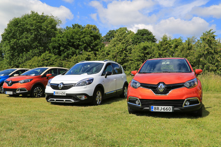 influential: PIIKKIO, FINLAND - JULY 19, 2014  Red Renault Captur Cars and a White Scenic Xmod on display  Renault Captur wins its category in the influential Tow Car Awards 2014