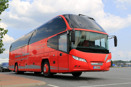 FORSSA, FINLAND - AUGUST 2, 2014  Red Neoplan Cityliner bus waits for passengers  Neoplan Cityliner in Euro 6 is tested to break 20-litre barrier on long-distance trip