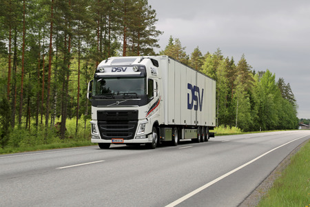 KOSKI, FINLAND - JUNE 1, 2014  Volvo FH trailer truck on the road  The Volvo FH Euro 6 features an improved main beam, enhanced static cornering lights and dynamic headlights  Editorial