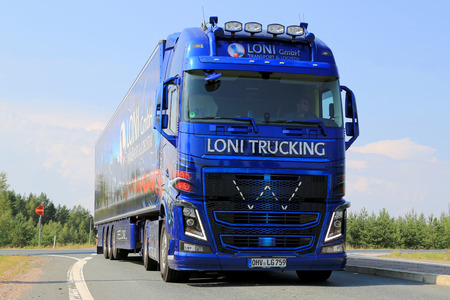 LEMPAALA, FINLAND - AUGUST 7, 2014  German Volvo FH Show Truck of Loni Gmbh arrives at Lempaala as part of the truck convoy to Power Truck Show 2014 in Alaharma, Finland